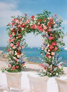 We absolutely love pops of color here at SMP, especially when it comes to florals AND the rest of the wedding has a completely neutral color palette like today's oceanside wedding! For these two, shar...