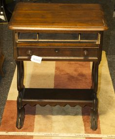THE PERFECT PIECE FOR THE ULTIMATE DIY UPCYCLER - THIS CARVED SOLID WOOD SIDE TABLE FEATURES TWO DRAWERS AND A SMALL SHELF ON THE BOTTOM. THE FRONT OF ONE OF THE DRAWERS HAS BROKEN OFF. MEASURES 28 IN. H X 22 IN. W X 17 IN. D.