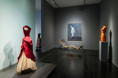 "Gowns made for Dominique de Menil, furnishings from the Menil home, Surrealist paintings and a dress form are on view in the exhibition ""A Thin Wall of Air: Charles James,"" at the Menil Collection through Sept. 7."