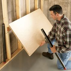 Build a fold-down workbench  DIY Tips for Your Garage - Article | The Family Handyman