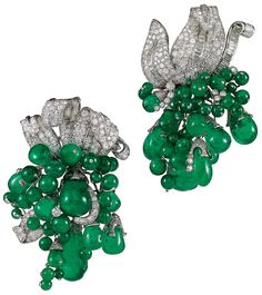 Paul Flato, A pair of highly articulated emerald bead, diamond and platinum clip brooches, circa 1936