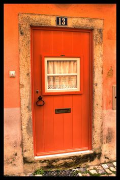 ...and the house is orange with an orange door and it is number 13 on the street