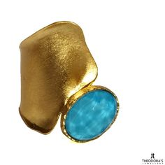Handmade gold plated silver ring with Quartz and Turquoise. The ring is adjustable and open. A perfect jewelry that will make you stand out----------------------------------------------------------------------------------------Χειροποίητο ασημένιο δαχτυλίδι από επιχρυσωμένο ασήμι και χαλαζία με τιρκουάζ. Το δαχτυλίδι προσαρμόζεται ως προς το μέγεθος καθώς είναι ανοιγόμενο στο επάνω μέρος και αυξομειώνεται ένα με δύο νούμερα. Ένα μοντέρνο κόσμημα που ταιριάζει σε κάθε τύπο γυναίκας.