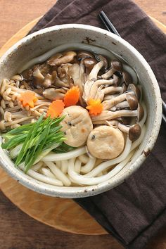 Three Mushrooms Udon for Fall    shimeji mushrooms, maitake mushrooms, enoki mushrooms, mini ganmodoki  (cooked all with soysauce, sake, mirin and sugar)  boiled carrot, long green onion,  Soup: shiro-dashi and mirin