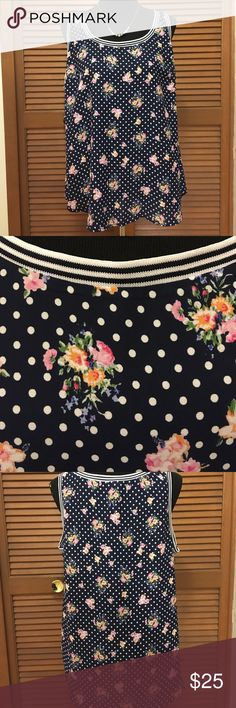 NWT Torrid plus size Navy floral polkadot top 1X Brand-new with tags. Navy and white polkadot floral sleeveless top from torrid. Torrid size 1. 100% polyester. torrid Tops Blouses