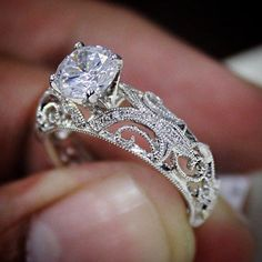 jewelry rings We absolutely love the scrollwork detail on this diamond engagement ring. Would you wear it? - We absolutely love the scrollwork detail on this diamond engagement ring. Would you wear it? Custom Wedding Rings, Wedding Rings Vintage, Diamond Wedding Rings, Vintage Engagement Rings, Diamond Engagement Rings, Wedding Jewelry, Solitaire Diamond, Solitaire Rings, Oval Engagement