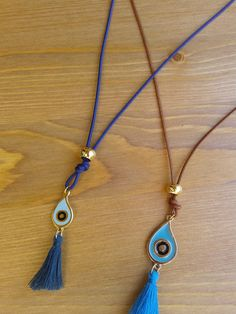 Handmade Necklaces with cord peephole and pompon by toocharmy