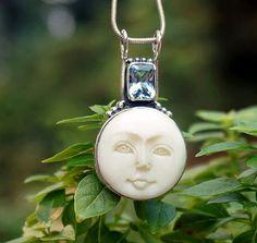 Moon Face and Blue Topaz pendant http://www.thesacredfeminine.com/topaz-jewelry.html
