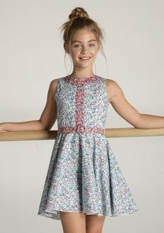 Her fit and flare dress. Liberty Print in the finest 100% soft Italian cotton…