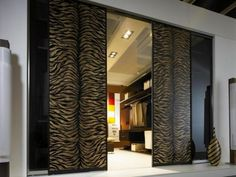 http://keepmihome.com/wp-content/uploads/2014/10/leopard-patterned-sliding-closet-door-with-lighting-ceiling-idea-and-white-tile-floor-801x601.jpg