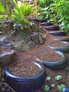 Recycled Landscaping Tire Garden steps look great. Why throw out such a wonderful resource? Please help to spread the word about sustainable gardening practices by sharing this image! Tire Garden, Garden Paths, Garden Art, Garden Landscaping, Garden Design, Landscaping Ideas, Garden Table, Tire Planters, Garden Planters