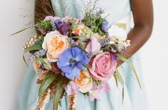 A rustic and romantic bridal bouquet with pops of blue