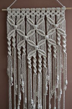 Wall panels handmade macramé technique. Material: 100% cotton. Color: white. Strap: natural wood - pine. Dimensions: The length of the strap to the bottom, including the thread - 127cm / 50 inches The width of wall hanging - 48cm / 18.9 inches