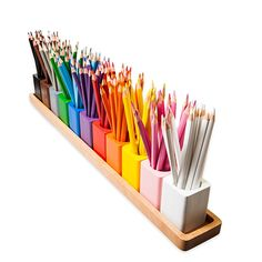 11 individual wooden pencil pots that neatly sit on a wooden stand. Here is the perfect way to store colouring pencils and \/ or felt-tip pens. The attractiveness of orderly colour coded pencils appeals to all. The pots have a robust stained finish and the woodgrain may show on some colours.Pencils not included, available separately.