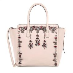 This collectible Valentino tote is in Pristine condition. It is made from exquisite nude leather and adorned with radiant clear and red crystals. Incredible used purse site