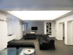 Translucent stretch ceiling in living room. This ceiling transmits about 50 % of light making your room lighter.