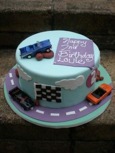 Racing Car Cake - I think this is really cool, but simple, could use edible or toy cars for decor and I bet I can find heaps of race car decor