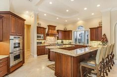 Wood custom cabinetry in this beautiful kitchen   11735 Valeros Court Location: Old Palm Golf and Country Club  www.oldpalm.us