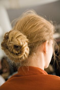 Braided chignon. looks easy (If you know how to fishtail braid). braid and then loop around like a bun, securing with hairpins.