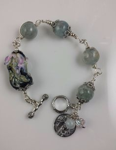 Aquamarine and sterling silver link bracelet with lampwork focal. One-of-a-kind creation from www.braceletstoo.com
