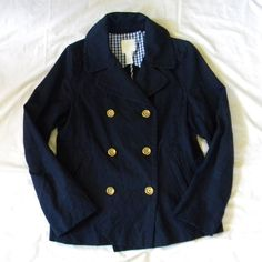 """J. Crew Indigo Pea Jacket Measures 19"""" across at armpits and 14.5"""" from armpit to bottom. Would likely fit size 8 or 10. Excellent condition. No stains, snags or tears. All buttons still intact. *This is a lighter weight spring or fall jacket.* Body 95% cotton/5% metallic. Lining 100% cotton. Sleeve lining 100% polyester. J. Crew Jackets & Coats Pea Coats"""