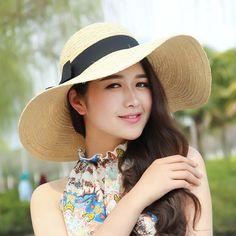 Bow straw sun hat for women wide brim summer wear