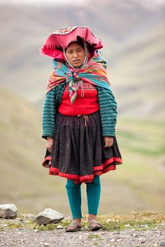 Young woman, named Maria, wearing traditional clothing in Peruvian Andes outside Cuzco, Peru, March 24, 2011