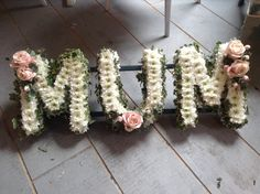 Funeral mum flower tribute Mum funeral letters, pink and white… - Modern Funeral Spray Flowers, Funeral Sprays, Funeral Floral Arrangements, Flower Arrangements, White Mums, Pink Gerbera, Funeral Tributes, Memorial Flowers, Funeral Memorial