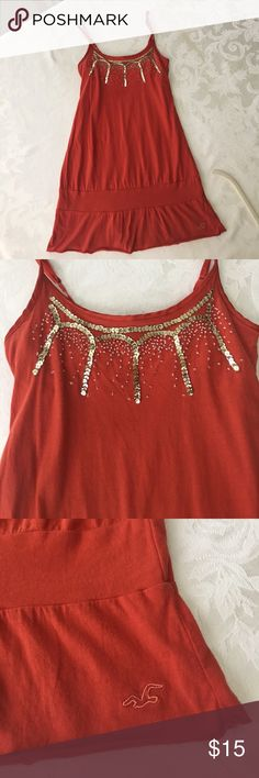 Hollister sequined tank top This is a beautiful rust color top with gold sequins and clear small beads. It's in perfect condition from a smoke and pet free home. Hollister Tops Tank Tops