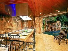 An entertainer's dream, the air-conditioned grotto is outfitted with a sushi bar, a fully equipped kitchen, a bathroom, and state-of-the-art surround sound and electronic equipment.