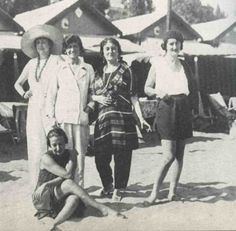 Misia (striped robe) with Coco Chanel (white pantsuit) 1923 in Venice