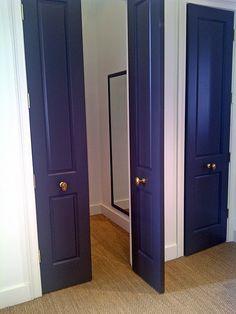 sisal carpeting + brass knobs + dark gray door Ann Mashburn shop- I've always loved these little brass oblong knobs