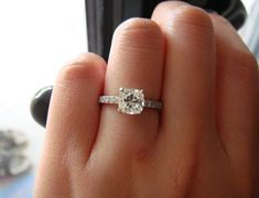 Forget pretty much every other ring on this board. This is it! Just make sure it's cushion cut.