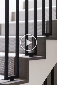 Chic staircase is fitted with modern iron spindles and covered in a gray herringbone stair runner. Chic staircase is fitted with modern iron spindles and covered in a gray herringbone stair runner. Stairs In Living Room, House Stairs, Carpet Stairs, Hall Carpet, Stairs With Carpet Runner, Basement Carpet, Stair Handrail, Staircase Railings, Stairways