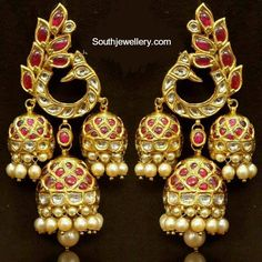 Gorgeous Temple jewellery earrings with a traditional peacock motif. See more on Wedding Vows. Indian Jewellery Design, Latest Jewellery, Jewelry Design, Indian Wedding Jewelry, Bridal Jewelry, Gold Jewelry, Indian Weddings, Jewellery Earrings, Gold Necklaces