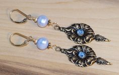 Brass flower and leaf stamping with blue rhinestone. 14k gold filled hooks and wire and beads, and blue freshwater pearls. by ChrisAllenJewelry on Etsy
