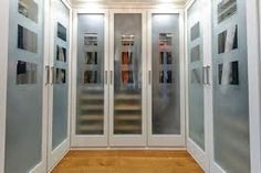 """dont like the """"cutouts"""" in the frosted glass but i would be sooo happy to have a closet this big and organized"""