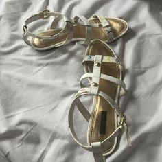 AUTHENTIC Louis Vuitton gladiator sandals Beautiful sandals! Sad to see them go but they are just a bit too small for me! There is the authenticity code on the inside of the shoe as well. Louis Vuitton Shoes Sandals