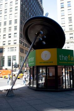 Needle threading a button sculpture in New York City. Been there !  Saw that!