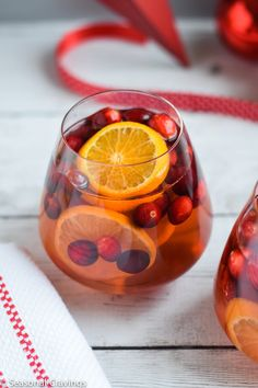 Five Ingredient White Sangria is perfect for any holiday or party. Your guests will love how festive it looks and it's easily made with white wine. #cocktail #booze #holiday