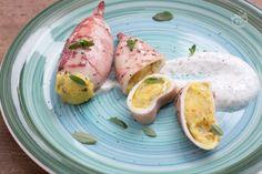 I totani ripieni al forno sono un secondo piatto di pesce molto gustoso,  un ripieno originale a base di patate, pane ammollato e curcuma.