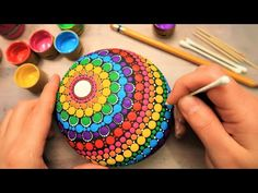 In this tutorial, I will give you step by step instructions on how to paint this beautiful, happy, rainbow dot art mandala stone using ONLY A CHAPSTICK LID, . Dot Art Painting, Mandala Painting, Stone Painting, Dot Painting Tools, Painted Fan, Painted Rocks, Stone Crafts, Rock Crafts, Mandela Art