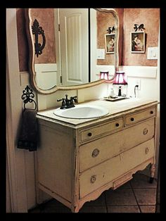 We bought an old dresser, dropped in a sink, tiled the top with tumbled marble (subway)- guest bathroom.
