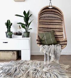 The coziest corner we'd love to cuddle up in. #interiors #hangingchair : @milou_nieuwenhuis