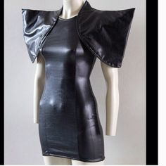 Spiked black avant grade designer dress Made by designer Andy Chrisst in Australia. Very stretchy spandex pvc look bodycon. It will fit sizes xxs-m. Dresses Mini