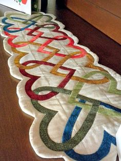 Love this Woven heart table runner but I would make the edges straight. Don't really care for the scallops on the sides and ends.