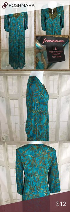 "Boutique Franseca Rose Swim Cover Size Small Boutique Franseca Rose Swim Cover Size Small. Beautiful Watercolor Teal with bamboo leaves. Accented with leopard / Floral button up Neckline. See through material - 100% Rayon. Loose and Flowing Maxi   Measures:  Pit to Pit:  22"". Length:  55"". Francesa Rose Swim Coverups"