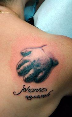 Baby hand tattoo