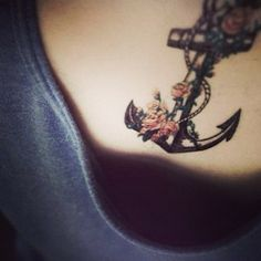 Anchor with roses tattoo, love it