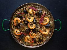 "Paella with Chorizo, Chicken, and Shrimp (Paella Mixta) - This over-the-top Americanized paella gets its smoky kick from paprika and chorizo. Why ""Americanized""? Traditional paella valenciana, as documented by David Rosengarten in ""The Art of Paella"", usually contains rabbit, snails, and chicken."